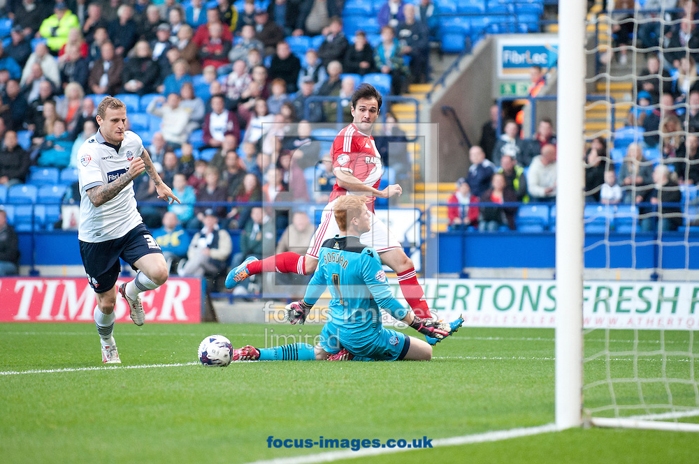 Kike of Middlesbrough attempts to roll the ball past Bolton Wanderers goalkeeper Adam Bogdan during the Sky Bet Championship match at the Macron Stadium, Bolton<br /> Picture by Russell Hart/Focus Images Ltd 07791 688 420<br /> 19/08/2014