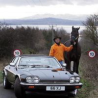 Derek Butcher, Knockhill Racing Circuit boss pictured with his horse 'Neason' and his Jaguar XJSC, near his home in Dalgety bay.<br />