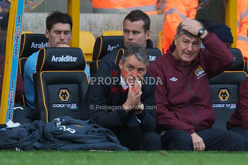 WOLVERHAMPTON, ENGLAND - Saturday, October 30, 2010: Manchester City's manager Roberto Mancini and assistant Brian Kidd look dejected as they watch their side lose 2-1 to Wolverhampton Wanderers during the Premiership match at Molineux. (Pic by: David Rawcliffe/Propaganda)
