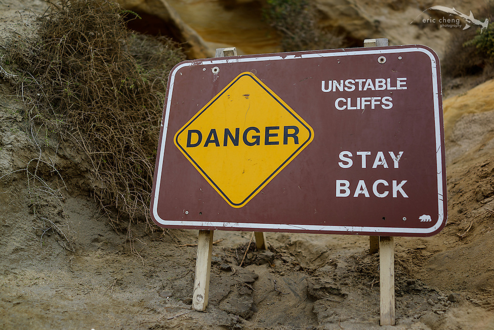Danger, unstable cliffs, stay back. Sandstone cliffs at the beach in Del Mar, San Diego, California