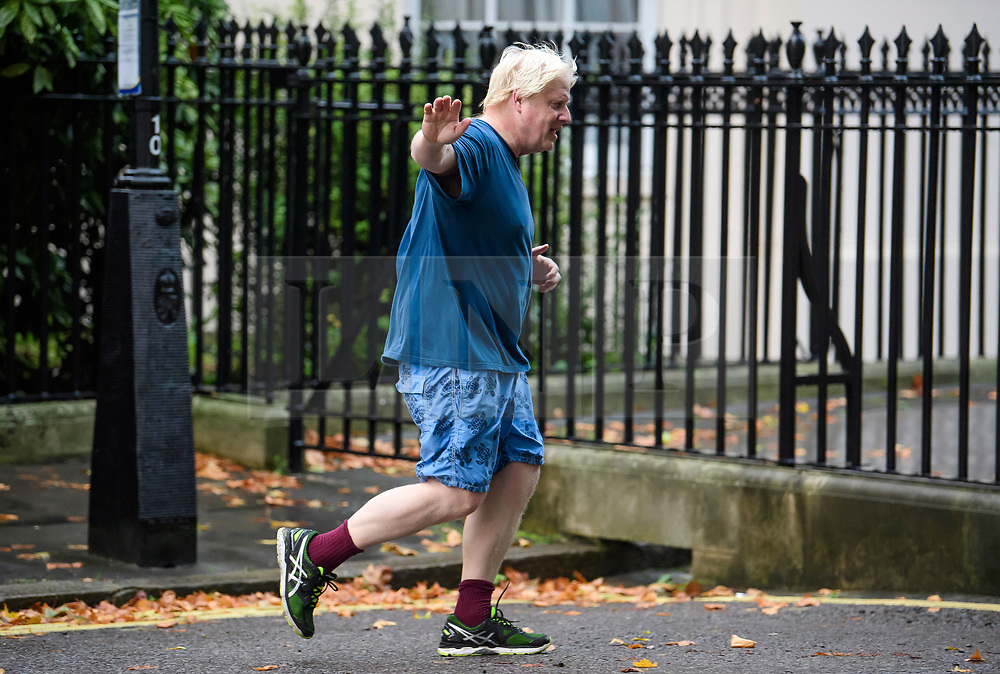 © Licensed to London News Pictures . 28/09/2017. London, UK. British foreign secretary BORIS JOHNSON, Seen running in Westminster, London on September 28, 2017. Boris Johnson has been accused of challenging government Brexit strategy ahead of Conservative Party Conference which starts in Manchester on Sunday. Photo credit: Ben Cawthra/LNP