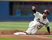 ATLANTA, GA - OCTOBER 2:  Centerfielder Ender Inciarte #11 of the Atlanta Braves slides into third base during the game against the Detroit Tigers at Turner Field on Sunday, October 2, 2016 in Atlanta, Georgia. (Photo by Mike Zarrilli/MLB Photos via Getty Images) *** Local Caption ***