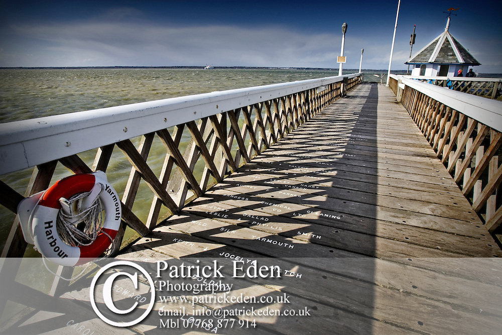 Yarmouth Pier showing planks with donors names on.  Isle of Wight photography photograph canvas canvases