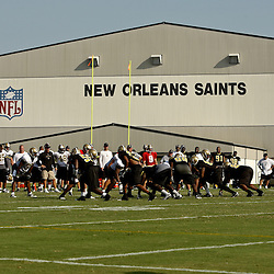 August 1, 2010; Metairie, LA, USA; New Orleans Saints run drills during a training camp practice at the New Orleans Saints practice facility. Mandatory Credit: Derick E. Hingle