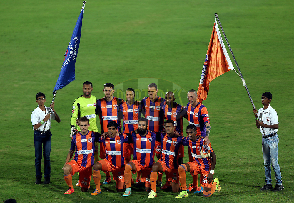 FC Pune City Team pose for the pix before the start of the match 44 of the Hero Indian Super League between FC Pune City and Atletico de Kolkata FC held at the Shree Shiv Chhatrapati Sports Complex Stadium, Pune, India on the 29th November 2014.<br /> <br /> Photo by:  Sandeep Shetty/ ISL/ SPORTZPICS