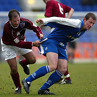 St Johnstone v Arbroath.. 08.03.03<br />Steven Florence holds back Chris Hay<br /><br />Pic by Graeme Hart<br />Copyright Perthshire Picture Agency<br />Tel: 01738 623350 / 07990 594431