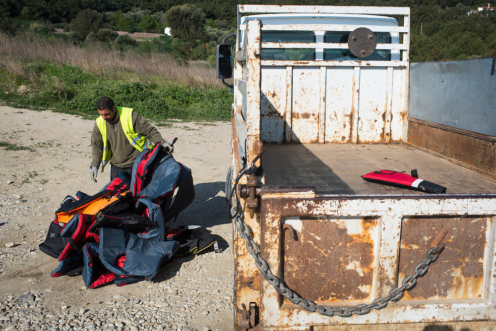 Discarded lifejackets are collected after a refugee boat landing on March 17, 2016 near Mitilini, Greece.
