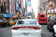 A Hot Wheels Star Wars First Order Stormtrooper Dodge vehicle, modeled after the new Hot Wheels line of Star Wars character cars, drives through New York's Times Square, Friday, Sept. 4, 2015, to celebrate Force Friday. (Photo by Diane Bondareff/Invision for Mattel/AP Images)