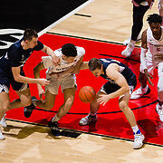 22 December 2018: San Diego State Aztecs guard Jordan Schakel (20) comes away with a steal from Brigham Young Cougars guard Connor Harding (44) in the first half. The Aztecs beat the Cougars 90-81 Satruday afternoon at Viejas Arena.