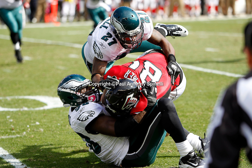 Atlanta Falcons tight end Michael Palmer (81) gets tackled by Philadelphia Eagles linebacker Moise Fokou (53) and Eagles safety Quintin Mikell (27) during the NFL week 6 football game against the Philadelphia Eagles on Sunday, October 17, 2010 in Philadelphia, Pennsylvania. The Eagles won the game 31-17. (©Paul Anthony Spinelli)