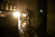 Chris hoses down the floor of a home in Far Rockaway, NY November 6, 2012 following the severe devastation from Superstorm Sandy.  Photo Ken Cedeno