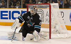 April 14, 2011; San Jose, CA, USA; San Jose Sharks goalie Antti Niemi (31) makes a glove save against the Los Angeles Kings during the first period at HP Pavilion. Mandatory Credit: Jason O. Watson / US PRESSWIRE
