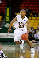 24 November 2005:  University of Alaska Anchorage senior guard Aaron Lawrence brings the ball down the court in the first half of the UAA Seawolves 60-65 loss to the South Carolina Gamecock's in the first round of the Great Alaska Shootout at the Sullivan Arena in Anchorage Alaska.