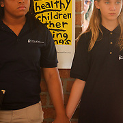 Shay Webb, left, 15, and Sophia White, 13, listen to a speaker Sunday September 21, 2014 during a celebration of International Day of Peace sponsored by Grandmothers for Peace at Hugh MacRae Park in Wilmington, N.C. (Jason A. Frizzelle)