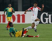 Photo: Steve Bond/Richard Lane Photography.<br />Mali v Benin. Africa Cup of Nations. 21/01/2008. Romuald Boco (R) of Benin & Accrington Stanley vaults a challange by Mohamadou Sidibe (L)