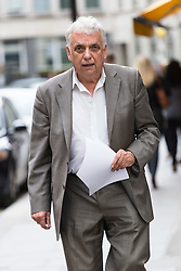 © Licensed to London News Pictures. 09/06/2015. London, UK. Tower Hamlets election petitioner ANDY ERLAM (Andrew Erlam) arrives at New Scotland Yard in central London on 8th June 2015. Andy Erlam and Danny Marks delivered new files of alleged evidence of election and financial fraud in Tower Hamlets to the Metropolitan Police Commissioner, Sir Bernard Hogan-Howe. Photo credit : Vickie Flores/LNP
