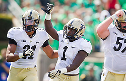 Sep 6, 2015; Huntington, WV, USA; Purdue Boilermakers running back D.J. Knox celebrates with wide receiver Anthony Mahoungou after scoring during the first quarter at Joan C. Edwards Stadium.  Mandatory Credit: Ben Queen-USA TODAY Sports