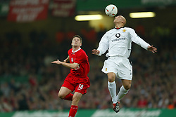 CARDIFF, WALES - Sunday, March 2, 2003: Liverpool's Michael Owen and Manchester United's Wes Brown during the Football League Cup Final at the Millennium Stadium. (Pic by David Rawcliffe/Propaganda)