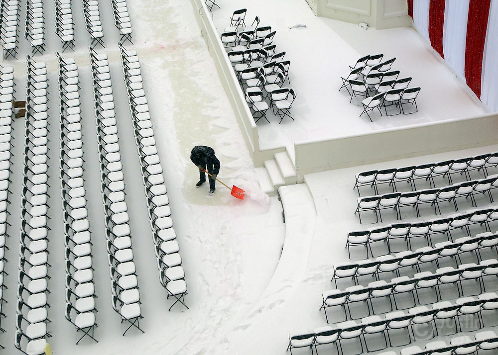 A worker shovels snow off of the site of United States President George Bush's Inauguration, which is taking place tomorrow, in Washington DC Wednesday 19 January 2005.