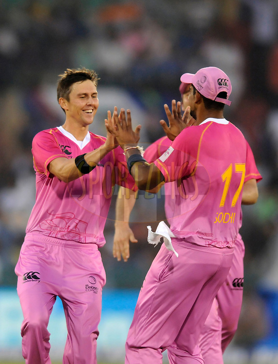 Trent Boult of Northern Districts celebrates the wicket of Ahmed Shehzad of Lahore Lions during the qualifier 3 match of the Oppo Champions League Twenty20 between the Northern Knights and the Lahore Lions held at the Chhattisgarh International Cricket Stadium, Raipur, India on the 14th September 2014<br /> <br /> Photo by:  Pal Pillai / Sportzpics/ CLT20<br /> <br /> <br /> Image use is subject to the terms and conditions as laid out by the BCCI/ CLT20.  The terms and conditions can be downloaded here:<br /> <br /> http://sportzpics.photoshelter.com/gallery/CLT20-Image-Terms-and-Conditions-2014/G0000IfNJn535VPU/C0000QhhKadWcjYs