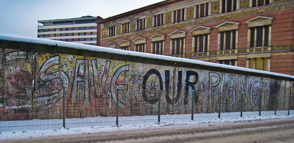 The Wall from the East Berlin Side, looking at the former compound office block of the German Wehrmacht.<br /> <br /> Who could be listening to this message now? There are no captives, yet there are many.