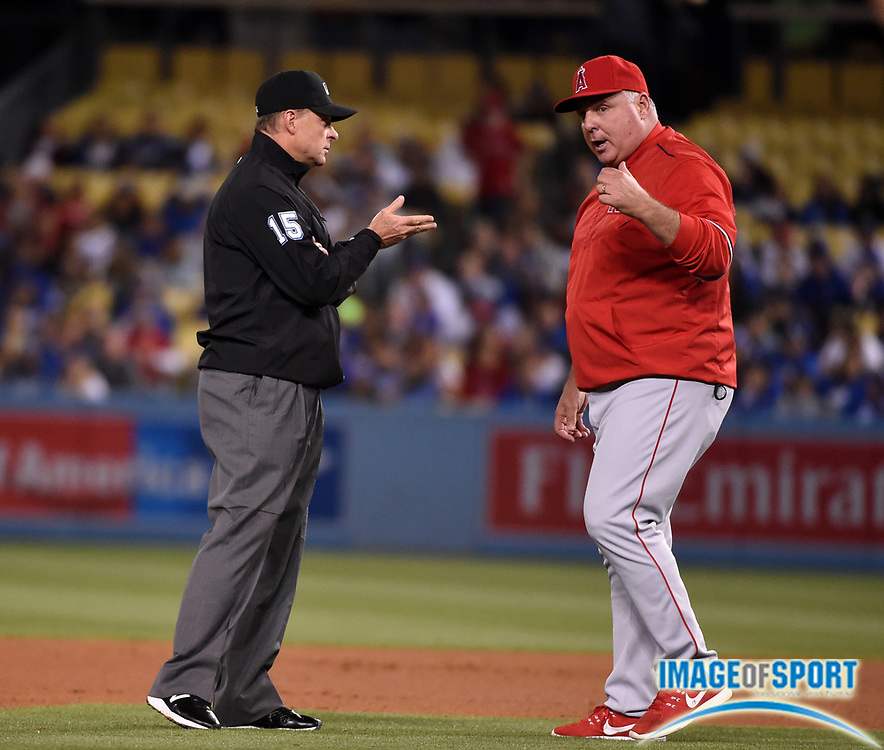 May 16, 2016; Los Angeles, CA, USA; Los Angeles Angels manager Mike Scioscia (14) argues with umpire Ed Hickox (15) during an interleague MLB game against the Los Angeles Dodgers at Dodger Stadium.