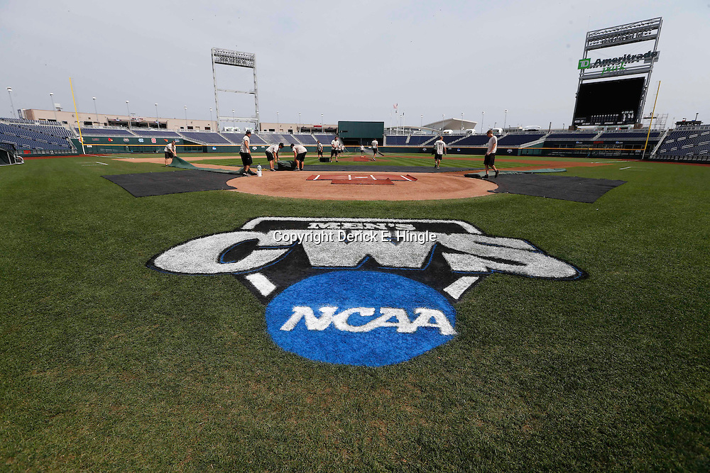 Jun 24, 2013; Omaha, NE, USA; Grounds crew prepare the field before game 1 of the College World Series finals between the UCLA Bruins and the Mississippi State Bulldogs at TD Ameritrade Park. Mandatory Credit: Derick E. Hingle-USA TODAY Sports