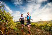 Trail Runners on the North Coast opf South Africa. Salomon team runners, the Erasmus brothers Andrew and Steven, are Athletes that can smile through the pain!