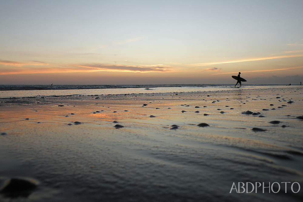Surfers at Sunset on Kuta Beach Bali Indonesia