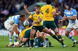 Will Genia of Australia passes the ball - Mandatory byline: Patrick Khachfe/JMP - 07966 386802 - 25/10/2015 - RUGBY UNION - Twickenham Stadium - London, England - Argentina v Australia - Rugby World Cup 2015 Semi Final.