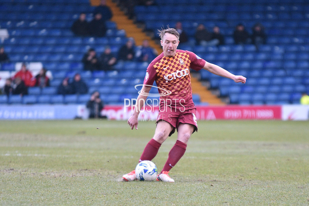Bradford City Defender, Anthony McMahon crosses during the Sky Bet League 1 match between Bury and Bradford City at the JD Stadium, Bury, England on 5 March 2016. Photo by Mark Pollitt.