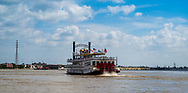 New Orleans, LA, USA -- May 27, 2019.  The paddle wheel boat Creole Queen makes its way along the Mississippi River.
