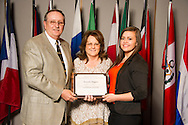 Canute native Amanda Higgins (right), an animal science major, receives an Oklahoma State University Leon Williams Scholarship from Leon and Linda Williams (left) at the university's recent College of Agricultural Sciences and Natural Resources Scholarships and Awards Banquet. The scholarship is part of more than $1.4 million in scholarships and awards presented to CASNR students for the 2016-2017 academic year. (Photo by Todd Johnson)
