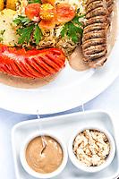 Salsichão servido no Biergarten. Joinville, Santa Catarina, Brasil. / <br /> Sausage served at Biergarten. Joinville, Santa Catarina, Brazil.