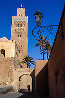 Morocco, Marrakesh. The Koutoubia Mosque is the largest mosque in Marrakech. Man entering a gate.