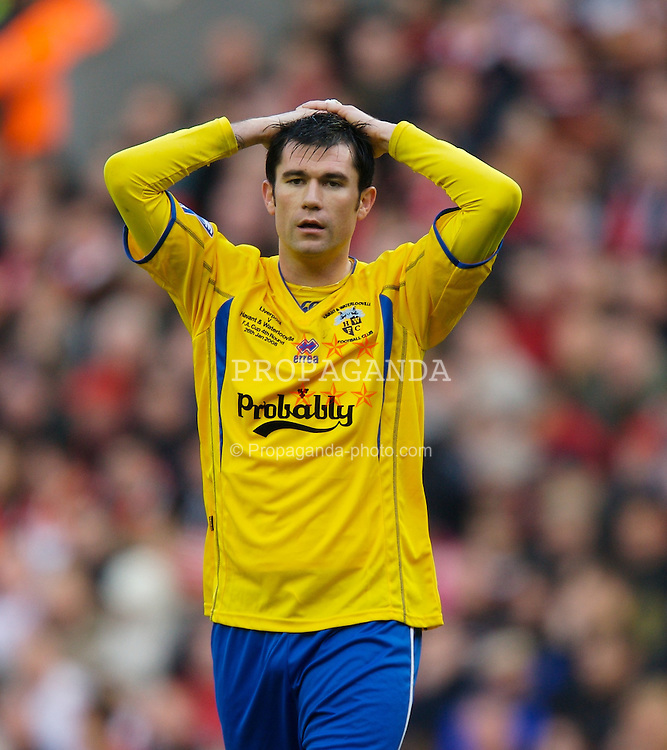 LIVERPOOL, ENGLAND - Saturday, January 26, 2008: Havant and Waterlooville Mo Harkin looks dejected as his side lose 5-2 to Liverpool during the FA Cup 4th Round match at Anfield. (Photo by David Rawcliffe/Propaganda)