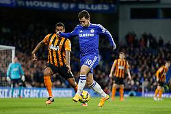 Eden Hazard of Chelsea is challenged by Tom Huddlestone of Hull City - Photo mandatory by-line: Rogan Thomson/JMP - 07966 386802 - 13/12/2014 - SPORT - FOOTBALL - London, England - Stamford Bridge - Chelsea v Hull City - Barclays Premier League.