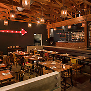 Industrial Modern are the words used to describe the new Bankers Hill Bar & Restaurant in San Diego. The interiors are rough, textured and visually interesting, comprised of blued steel, recycled factory components and other cultural artifacts and relics. Design by Paul Basile. San Diego Architectural Photographer, Southern California Architectural Photographer