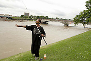 "Dominique Smith tries fishing from the top of the Great Miami River levy by the Monument St. bridge in downtown Dayton, Wednesday, June 4, 2008.  He lives in the neighborhood, and comes over to fish, ""every now and then,"" adding that it's just for fun, not food."