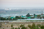 Ashgabat, Turkmenistan - 2017 September 22: Bagyr City (Bagyr is located some 14 km on West of Ashkhabad, the country's capital city) with Gypjak Mosque in background while 2017 Ashgabat 5th Asian Indoor &amp; Martial Arts Games on September 22, 2017 in Ashgabat, Turkmenistan.<br /> <br /> Mandatory credit:<br /> Photo by &copy; Adam Nurkiewicz<br /> <br /> Adam Nurkiewicz declares that he has no rights to the image of people at the photographs of his authorship.<br /> <br /> Picture also available in RAW (NEF) or TIFF format on special request.<br /> <br /> Any editorial, commercial or promotional use requires written permission from the author of image.