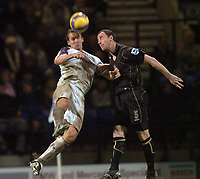 Photo: Paul Greenwood.<br />Bolton Wanderers v Portsmouth. The Barclays Premiership. 30/12/2006. Bolton's Kevin Davies. left and Pompey's Andy O Brien battle it out in the air