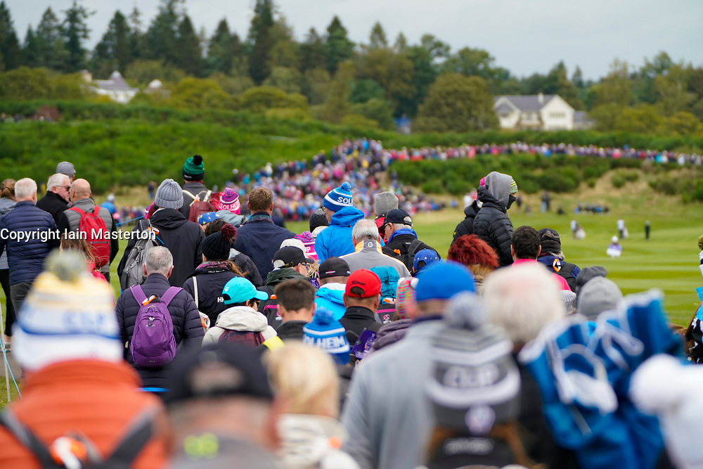Auchterarder, Scotland, UK. 14 September 2019. Saturday morning Foresomes matches  at 2019 Solheim Cup on Centenary Course at Gleneagles. Pictured; Many spectators walk along the 9th hole. Iain Masterton/Alamy Live News