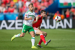 PARIS, FRANCE - Saturday, June 25, 2016: Wales' Ben Davies in action against Northern Ireland's Jamie Ward during the Round of 16 UEFA Euro 2016 Championship match at the Parc des Princes. (Pic by Paul Greenwood/Propaganda)
