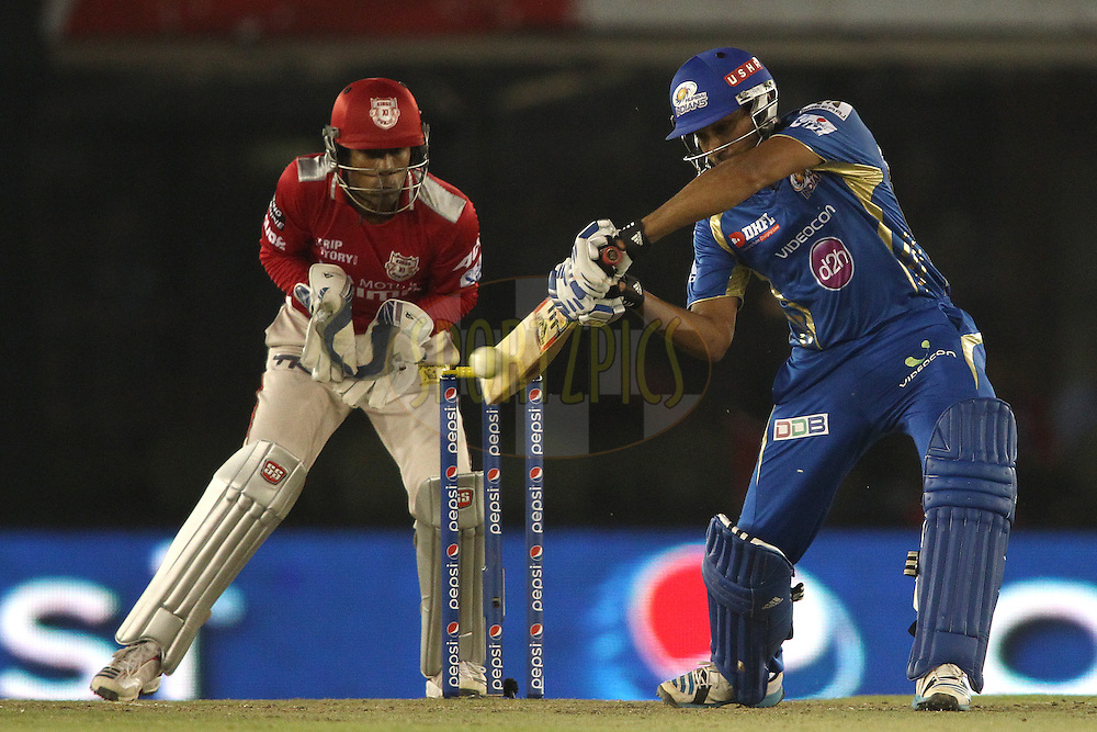 Rohit Sharma captain of of the Mumbai Indians square cuts a delivery during match 48 of the Pepsi Indian Premier League Season 2014 between the Kings XI Punjab and the Mumbai Indians held at the Punjab Cricket Association Stadium, Mohali, India on the 21st May  2014<br /> <br /> Photo by Shaun Roy / IPL / SPORTZPICS<br /> <br /> <br /> <br /> Image use subject to terms and conditions which can be found here:  http://sportzpics.photoshelter.com/gallery/Pepsi-IPL-Image-terms-and-conditions/G00004VW1IVJ.gB0/C0000TScjhBM6ikg