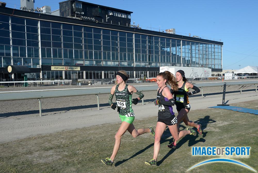 Dec 7, 2013; Portland, OR, USA; Sarah Baxter (left), Elise Cranny (center) and Alexa Efraimson lead the girls race in the 2013 Nike Cross Nationals at Portland Meadows Race Track. Efraimson won in 16:50. Cranny was second in 16:53 and Baxter was third in 16:57.