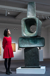 "© Licensed to London News Pictures. 18/11/2016. London, UK. A staff member views ""Parent I"" by Dame Barbara Hepworth (est. GBP2-3m), at the preview at Sotheby's of works on view at four upcoming November auctions featuring Modern & Post-War British Art, A Painter's Paradise (Julian Trevelyan & Mary Fedden at Durham Wharf), Scottish Art and Picasso Ceramics from the Lord & Lady Attenborough Private Collection. Photo credit : Stephen Chung/LNP"