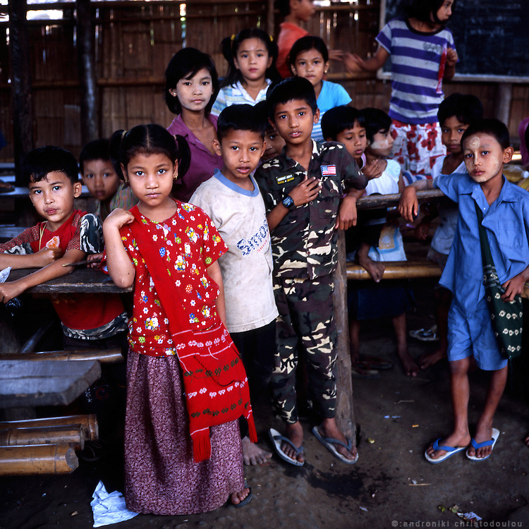 "Schoolchildren inside the refugee school in Mae La. Burmese refugee camp ""Mae La"" is north of border-town Mae Sot and lies along the Thai-Burmese border on the side of Thailand. Approximately 50,000 people live there. 38,167 was the official number of registered people in November 2009, according to the Thailand Burma Border Consortium (TBBC), and the rest are unregistered or people who come and go."