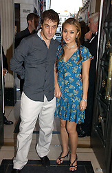 BRUCE WILPON and his wife YUKI OSHIMA-WILPON at a party to celebrate the re-opening of the David Morris Flagship store at 180 New Bond Street, London on 14th June 2006.<br />