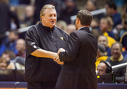 Nov 28, 2016; Morgantown, WV, USA; West Virginia Mountaineers head coach Bob Huggins talks with Manhattan Jaspers head coach Steve Masiello prior to the game at WVU Coliseum. Mandatory Credit: Ben Queen-USA TODAY Sports