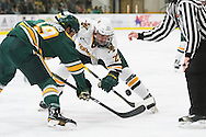 Vermont's Rob Darrar (23) and Clarkson's Brett Gervais (19) battle for a face off during the men's hockey game between the Clarkson Golden Knights and the Vermont Catamouts at Gutterson Fieldhouse on Saturday night October 8, 2016 in Burlington. (BRIAN JENKINS/for the FREE PRESS)